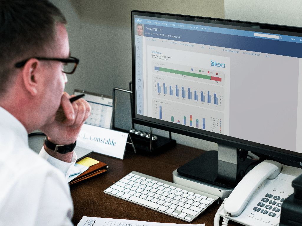 Mockup of a physician using an EMR displaying a cliexa PULSE report
